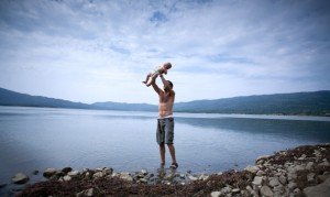 Papa with baby Hanna in the lake near Rache (Georgia)