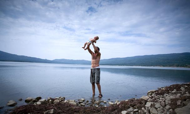 Papa with baby Hanna in the lake near Rache (Georgia)
