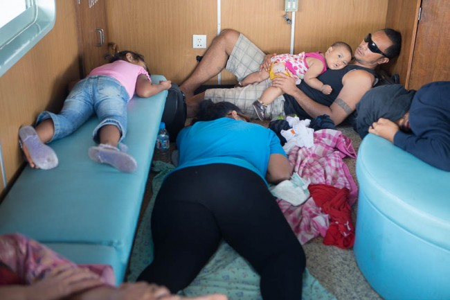 Tonga: A family sleeping on the ferry boat; Photo: Thomas Alboth