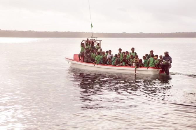 Atchin (Vanuatu, Malekula): School kids driving home