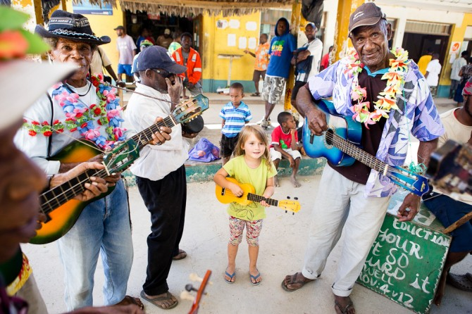 Hanna playing ukulele with the boys in Vanuatu (South Pacific)