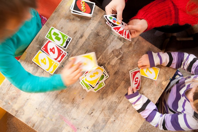 Uno card game - kids, hands