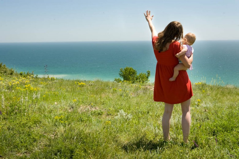 Mother with child looking on the sea