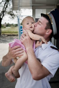 Policemen and baby in Besland (Russian Federation, North Ossetia)