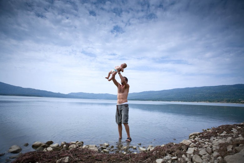 Father with toddler on a lake