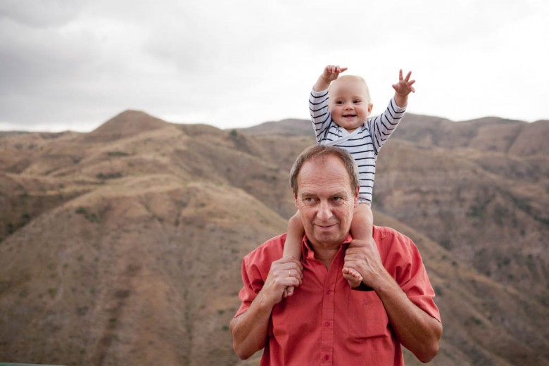 Baby on the shoulder of her grandfather, Armenia
