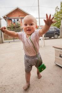Dirty baby walking