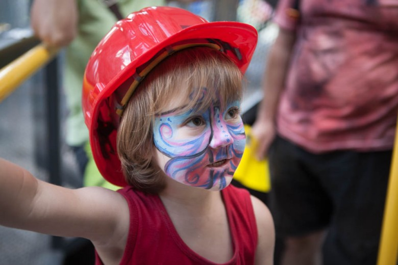 Little girl with painted face and helmet