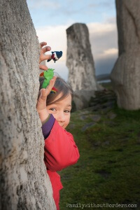 Kid playing puppets in the Callanish Standing Stones (Scottland)